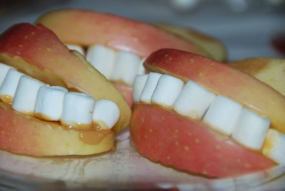 Apples, mini marshmallows and peanut butter (or Wow Butter for my allergic little guy) - great idea for a Halloween treat