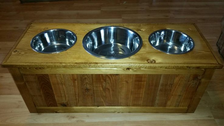 Rustic raised dog feeder with storage, three bowl raised dog feeder, Elevated dog feeder with 3 bowls by LilBitRustic on Etsy https://www.etsy.com/listing/217045890/rustic-raised-dog-feeder-with-storage