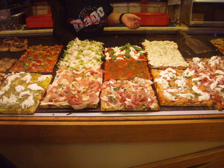 Pizza al taglio in Roma. You pay by the kg. They cut it, you fold, you eat while walking.