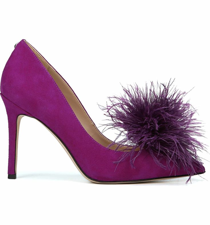 A feather pompom amps up the playfulness of a sophisticated pointy-toe pump lofted by a slim high heel.