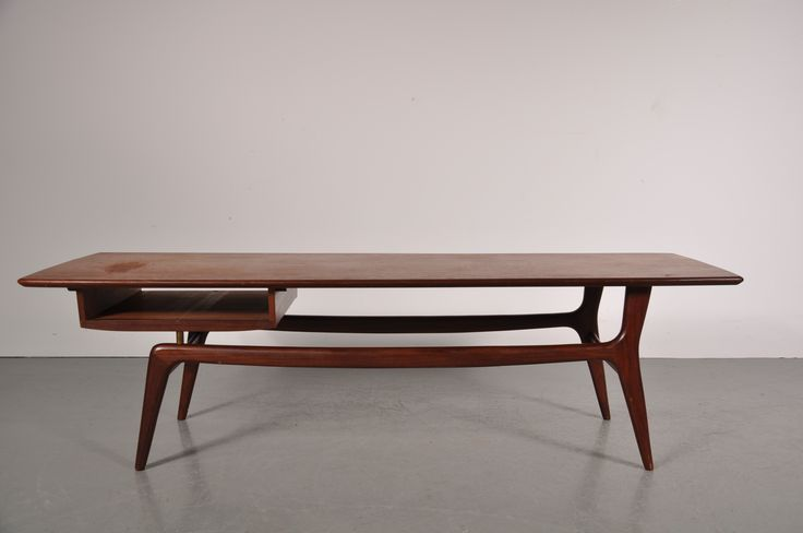 Louis van Teeffelen for Webe. 1950's Beautiful styled teak coffee table with magazine rack.