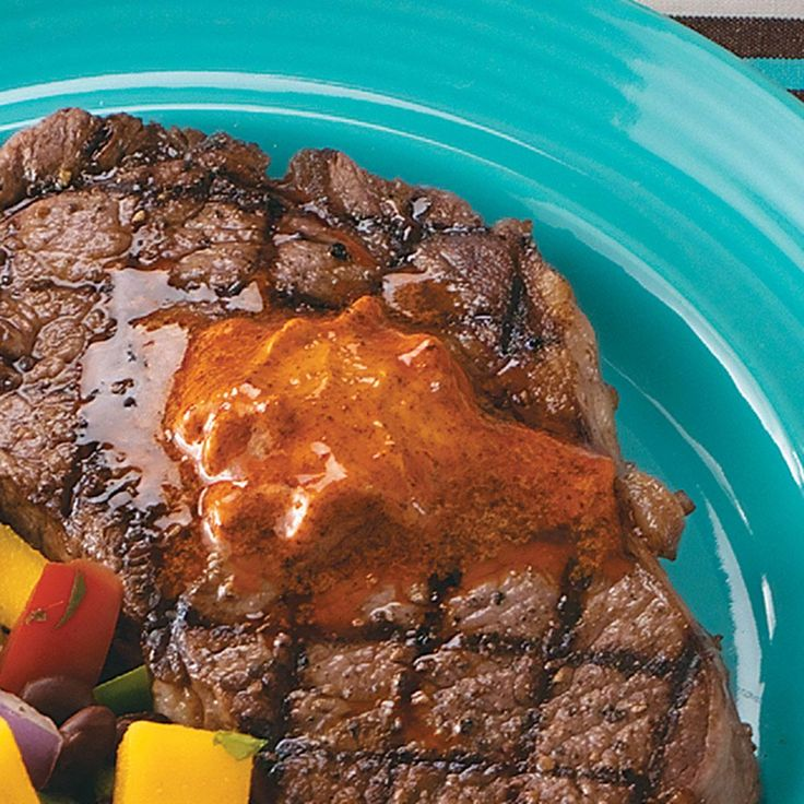 Ribeyes with Chili Butter Recipe -A couple spoonfuls of spicy butter instantly give steak a delicious Southwestern slant. Meat lovers will be delighted by the chili and mustard flavors. —Allan Stackhouse Jr., Jennings, Louisiana