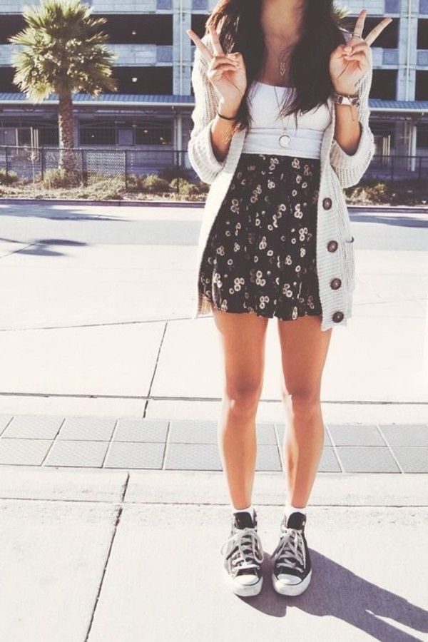 Over sized cardigan cream knit, black floral high waisted skirt.