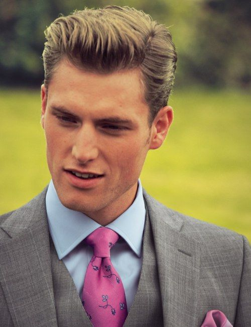 Grey suit, pink tie, and matching pink pocket square, via Billionaire Boys' Club.