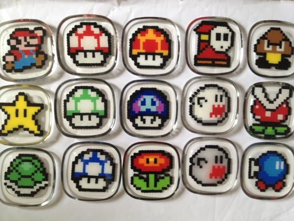 Super Mario Bros. coasters made with perler beads and resin .very cool