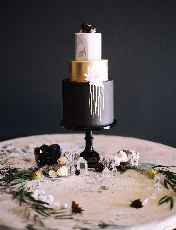 Beautiful black, gold and marble wedding cake by Sweet and Saucy Shop.