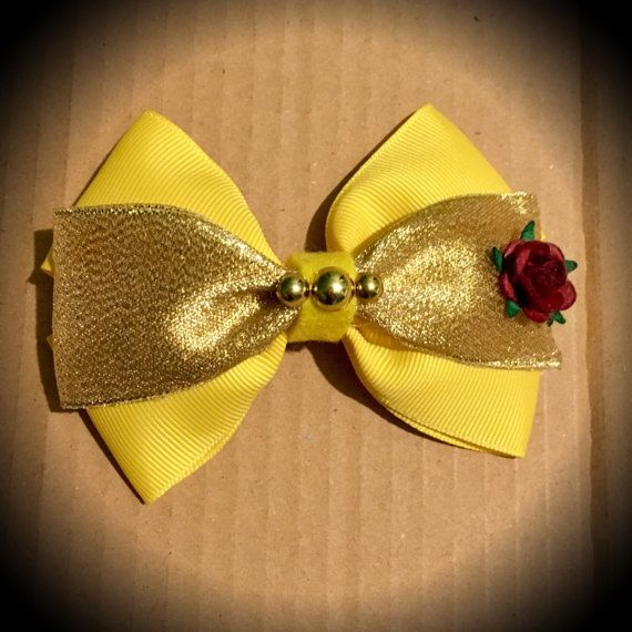Belle Beauty and the Beast Disney Princess Style Bow. Yellow Grosgrain and gold glitter Ribbon, Gold Bead Centre and rose detail. Mounted on an alligator clip. I can do custom bows, just let me know if youd like something specific. Price is for single bow.