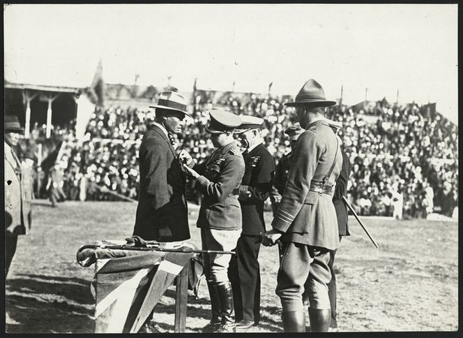 Date: 29 April 1920  Ref: PAColl-9163-07  Edward Prince of Wales presenting medals to returned sevicemen, Arawa Park, Rotorua, New Zealand. Photographed by an unknown photographer 29 April 1920.