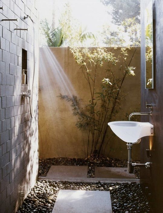 small corner outdoor shower and washroom
