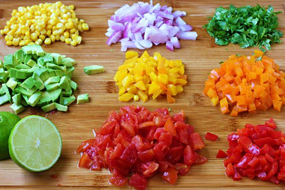 Colorful Summer Salsa Recipe with red, orange, yellow bell pepper, red onion, corn, avocado, tomato, lime, cumin and cilantro