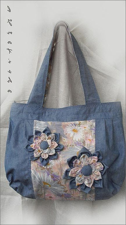 Flower of denim fabrics for bags.  http://www.handmadiya.com/2012/07/flower-of-denim-fabrics-for-bags.html