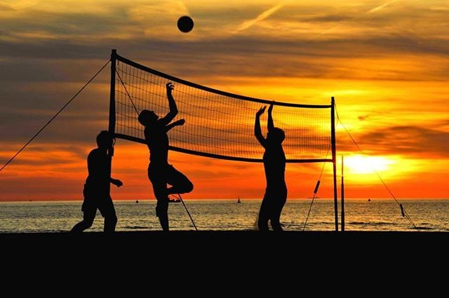 Beach Volleyball A Favorite Among Summer Sports First Appeared In Santa Monica California During The 1920 S This Much Love Beach Volleyball Beach Photos Photo