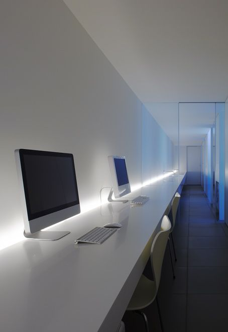 Extra long working surface inside the Minimalist House by Shinichi Ogawa. Photo by Jonathan Savoie  Architecture.