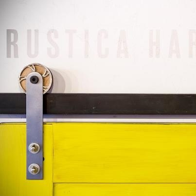 Great touch - This custom wheel is added to Modern Barn Door Hardware to give a unique look.