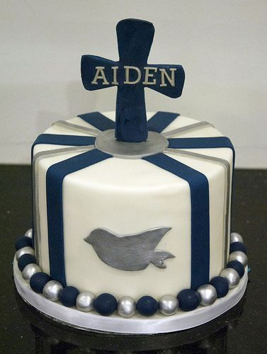 A navy blue and white boy's first communion cake. Created by www.fortheloveofcake.ca in Toronto