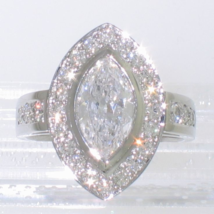 Platinum halo ring with 2 carat marquise-shaped Diamond and round brilliant melee
