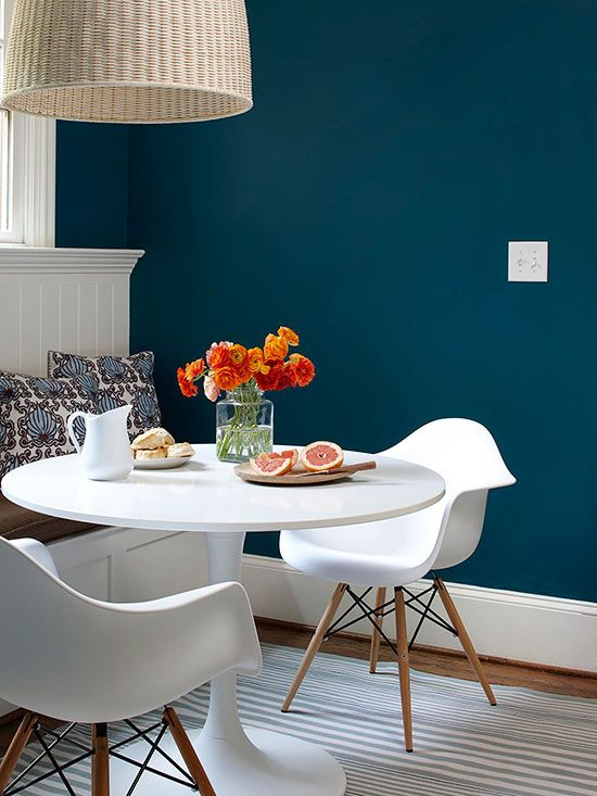 deep peacock blue + white with a pop of orange for bedroom or laundry room