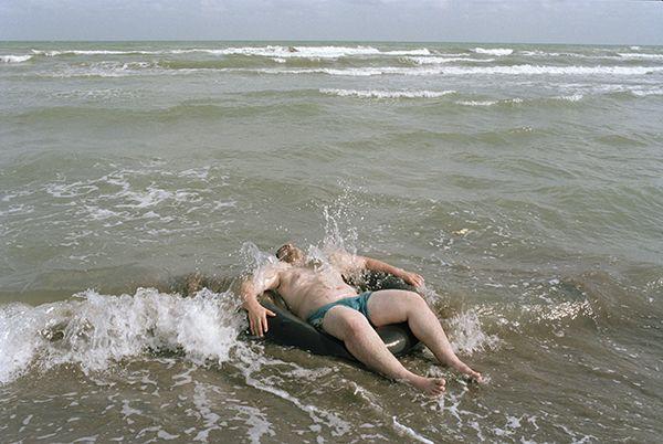 Jodi Bieber. BEACH OF THE TRUE BELIEVERS, CASPIAN SEA, IRAN 2006. Archival pigment ink on cotton paper, 95 x 79cm.