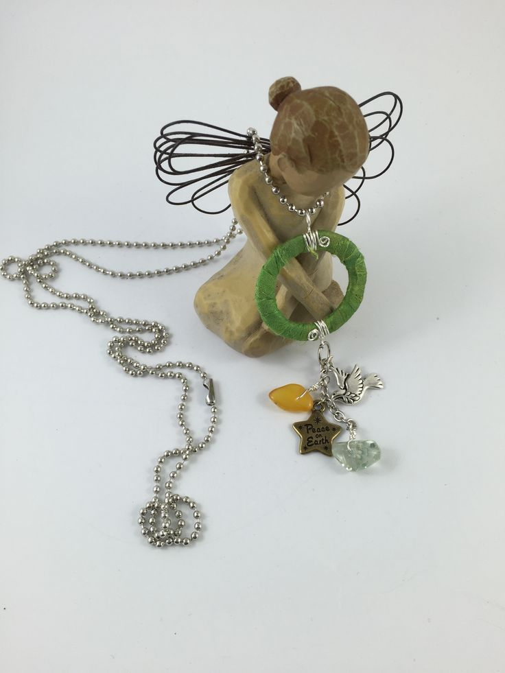 """A new addition to my """"Peace on Earth"""" range. Sari silk wrapped ring with dangles- PoE star, dove, amber and green amethyst, hanging on a long ball chain necklace."""
