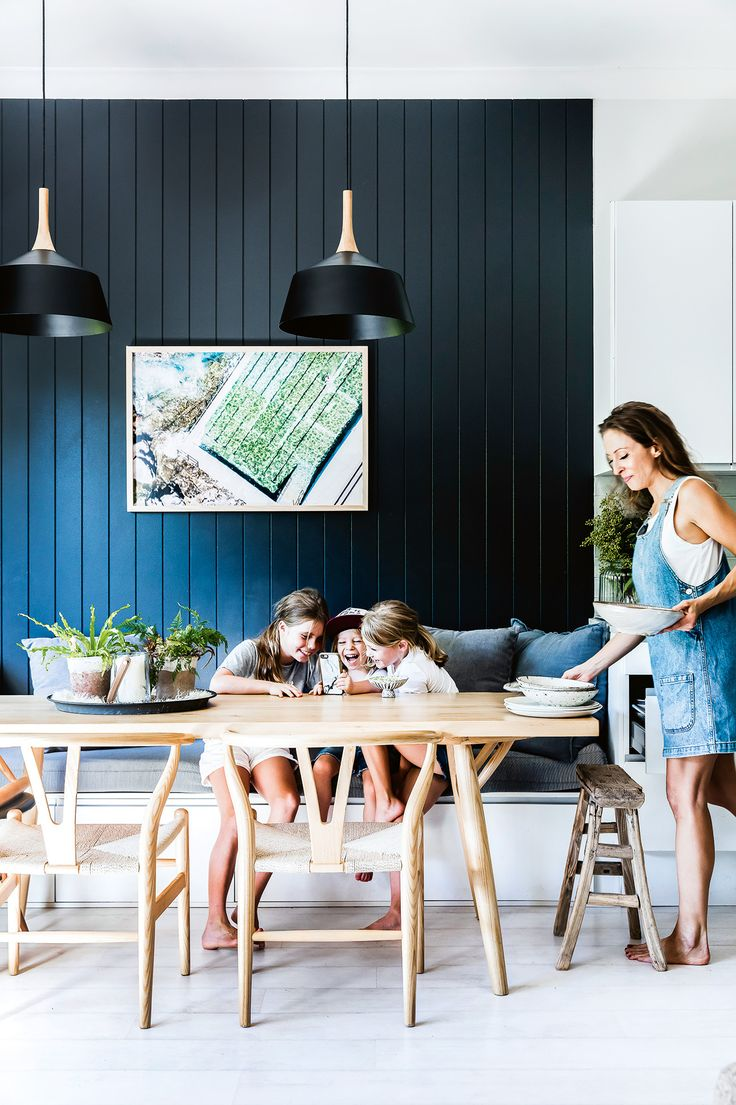 'Husk' pendant lights from Beacon Lighting and dark timber panels create a bold look. Alex's son Raffy plays at the table with his older cousins Maisie and Flo on either side. Photographic print by Paul McMahon. This Bondi bungalow flows perfectly between indoor and outdoor. Photography by Maree Homer. Styling by Hande Renshaw. From the December 2017 issue of Inside Out Magazine. Available from newsagents, Zinio, https://au.zinio.com/magazine/Inside-Out-/pr-500646627/cat-cat1680012#/  and…