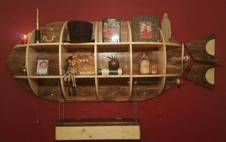 This steampunk zeppelin wall mounted shelving unit is almost 7 foot long. It was custom made by PLP Woodworks
