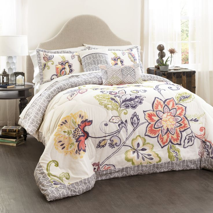 Elegant and welcoming, this beautiful 5-piece comforter set will add charm and comfort to your bedroom. The set includes one comforter, two pillow shams, and two decorative pillows. The quilt and shams display a lovely floral design.