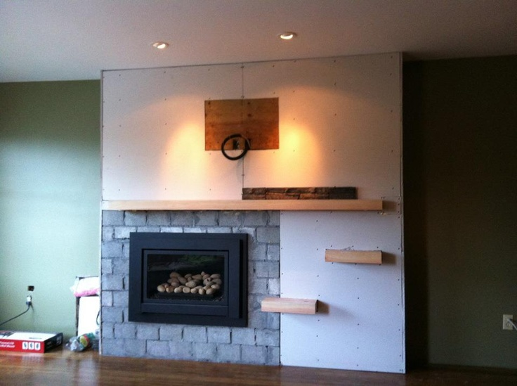 Shelves on, drywall/fireboard up.
