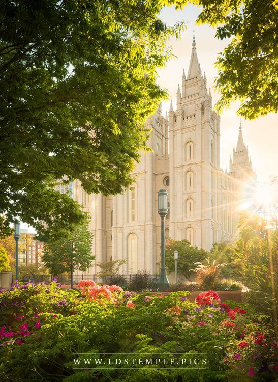 Salt Lake Temple The Lord Is My Light Vertical - Beautiful, warm evening light at Temple Square and the Salt Lake Temple (vertical format).