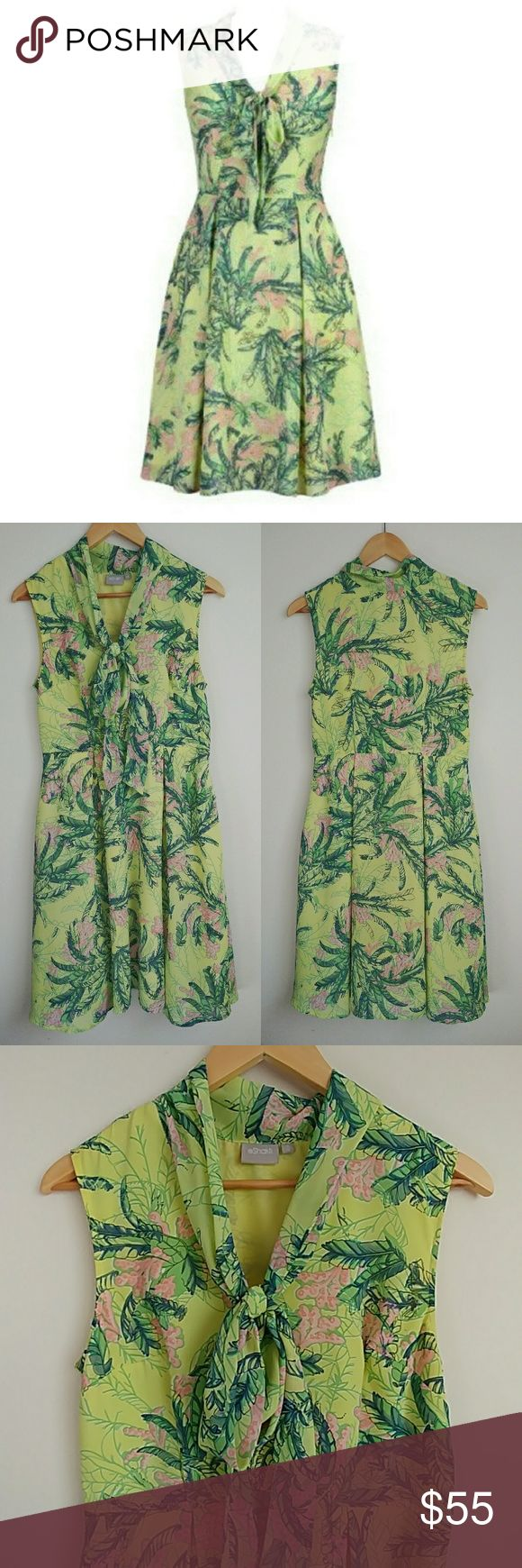 """Eshakti Banana Leaf Palm Tie Neck Dress This dress gives a tropical flair to modest secretary style! One of my absolute favorites. Worn a handful of times. Still looks like new! Generous necktie you can tie any style you want! A-line skirt with flattering pleats. Sleeveless. Knee length. Vibrant palm leaves & flowers print. POCKETS! Invisible side zip. Fully lined. Just waiting for a cardigan topper to rock this season! Length: 39"""" Waist: 30"""" Bust: 35"""" Material does not stretch. 100%…"""