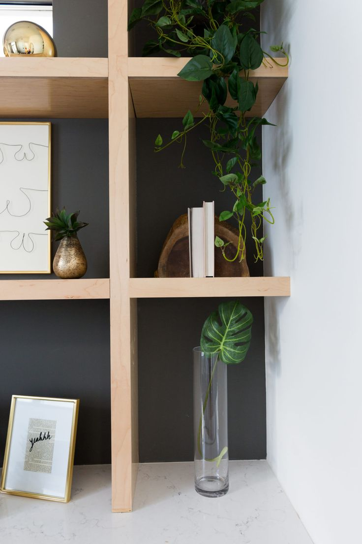 Built-in shelves give lots of opportunities to play with decor (such as this draping plant)
