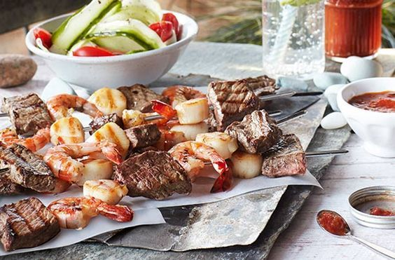 Slimming World's surf and turf skewers with fresh ketchup are ideal for the summer. They're really simple to cook and assemble and when they're served with light, homemade ketchup you just can't go wrong! This mouth-watering recipe takes about 1hr and 30 mins to prepare and cook and is well worth the wait. This recipe serves 4 people but double the quantities if you're feeding more. You can cook these steak, prawn and scallop kebabs on the BBQ.