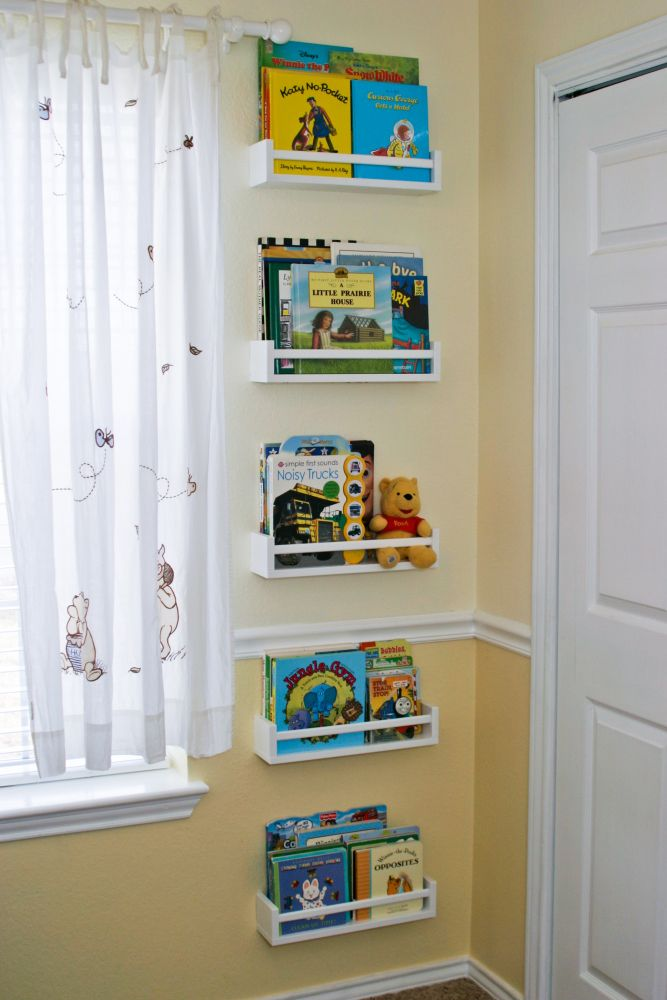 $4 IKEA Spice Racks Turned Kids Bookshelves. I would put them all at a reachable level. Books are for reading not just for decorating ;)