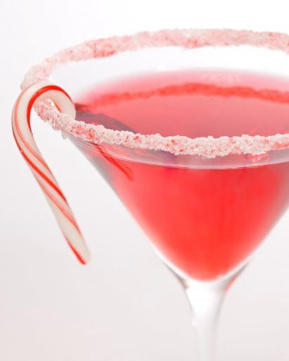 Candy Cane Cocktail With Candy Canes, Vodka, White Creme De Menthe, Cranberry Juice, Ice Cubes