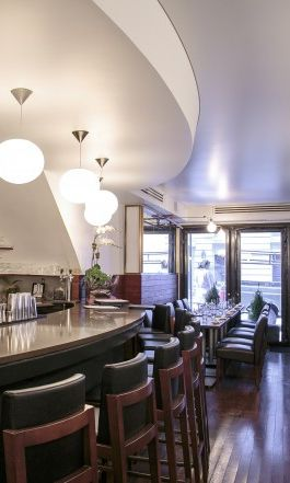 Get a taste of the Greek Islands in New York City at Loi Esiatorio, named after the restaurant's celebrity chef. Unwind while sampling from a superb menu of Mediterranean classics.