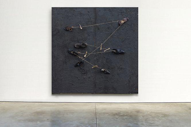 Łubkowski, plaque 31: asphalt, shoes, binder, bones, osb board, 200 x 200 cm