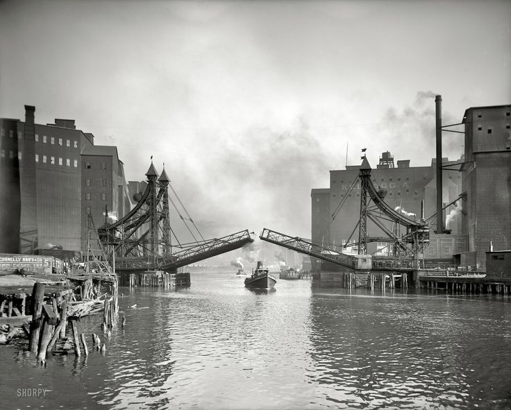 "1905 - Buffalo, New York. ""Jack-Knife Bridge, city Ship Canal, foot.""  Once thing that really gets me about all these city pictures is how much smog/clouds there are. I'm on a big fan of the EPA right now, but environmentalism has done a lot of good from when there wasn't any at all."