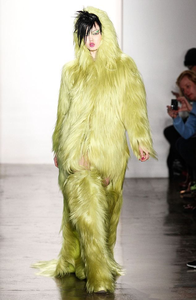Designer Jeremy Scott sent a model down the runway wearing a green fur coat and matching boots