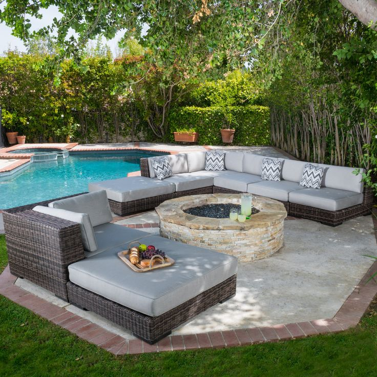 The Bowen Outdoor Sofa Set creates an exotic paradise in your own back yard. This set is known for its graceful curves and contemporary style. The rich brown color works well with the grey cushions in