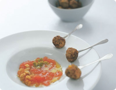 Meatballs served with tomato puree