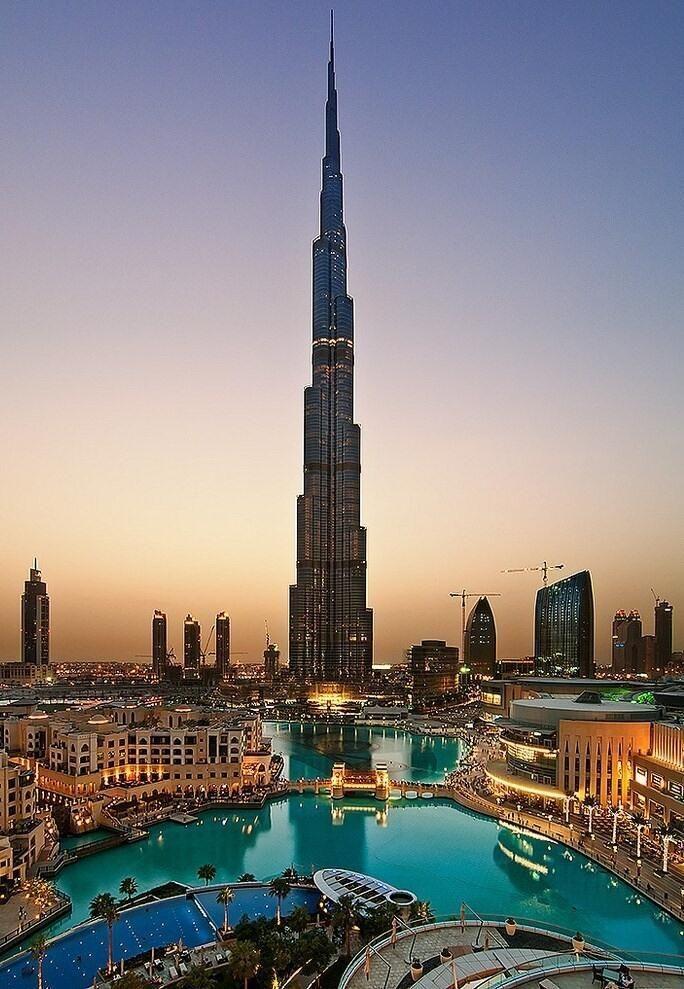 "Burj Khalifa (Arabic: برج خليفة, ""Khalifa Tower""), known as Burj Dubai prior to its inauguration, is a skyscraper in Dubai, United Arab Emirates, and is the tallest man-made structure in the world, at 829.8 m"