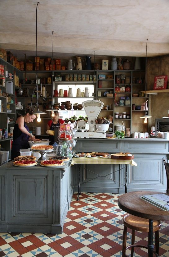 French bistrot. I think hubs would like the shelves all the way up & across the window!