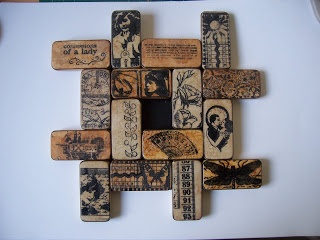 Altered dominoes made  into a wall plaque