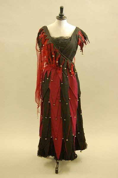 A court jester fancy dress costume made by Madame Elise circa 1890.