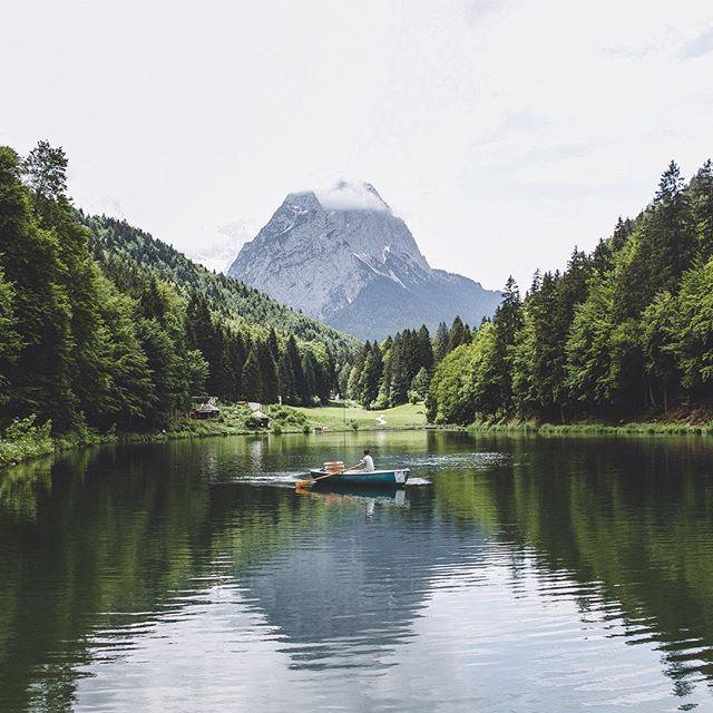 @davidnkollmann rowing among Zugspitz Mountain