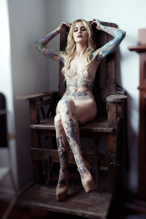 Nude girls with tattoos on her tits