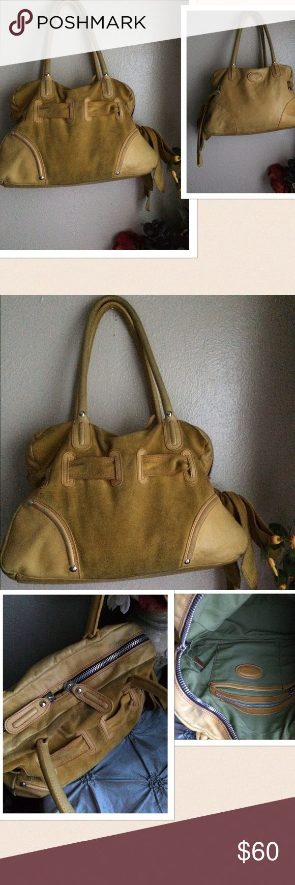 Sofia C Italian Handbag Sofia C Italian Handbag. Material: Leather and Suede. Color: Mustard. 2 way zipper closure. Belted design with tie bow closure. Inner compartments, fully lined. Preowned with some visible dirt marks on the outside, can be easily cleaned by an expert. Otherwise has lots of wear left. In Great condition. If this condition is not right for you do not purchase. Sofia C Bags Shoulder Bags