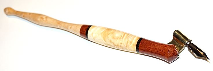 The pen with bubinga grip area, maple burl center, wenge rings and birdseye maple tail end is now an oblique
