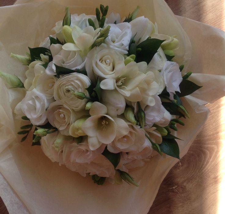 Akito roses, freesias, lisianthus, ranunculus and ruscus