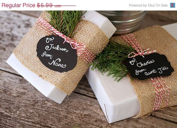 Burlap, bakers twine, fresh greens, and little chalkboard decals for wrapping details