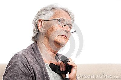 Disabled person with crutch, old senior woman in glasses, gray hair. Portrait, day dreaming, thoughtful, sad. Indoor, isolated on white.